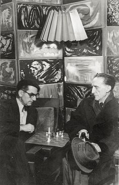 studio: Man Ray & Marcel Duchamp Playing Chess in Man Ray's Studio at 2 Bis, Rue Ferou, Paris, 1960 -by Man Ray. Got to learn chess first. Marcel Duchamp, Man Ray, Photo Portrait, Photo Art, The Dark Side, Chef D Oeuvre, Artistic Photography, Photography Portraits, Street Photography