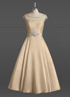 AZAZIE NYLA BG. Dress Nyla BG by Azazie is a lux satin and tulle bridal gown featuring an off-the-shoulder neckline on a tea-length A-line/princess skirt. #Bride #Wedding #CustomDresses #AZAZIE