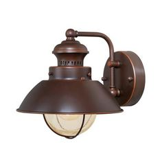 Features:  -Seeded glass.  -8'' Outdoor wall lantern.  Product Type: -Barn Light.  Fixture Material: -Metal.  Hardware Material: -Steel.  Shade Material: -Glass.  Bulb Type: -Incandescent.  Wattage: -
