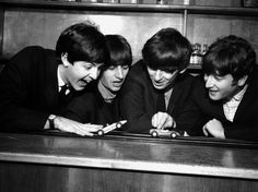 The Beatles in Coventry, amusing themselves with a miniture car race track before the show at Coventry theatre. 17th November 1963