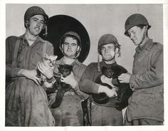 1943- U.S. soldiers who participated in the invasion of Kiska hold baby blue foxes they found on Segula Island. They named them Winken, Blinken, Stinken and Nod.