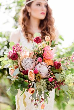 King protea wedding bouquet www.budsetc.net did all florals and decor for this bridal shoot