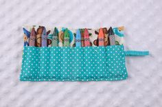 Blue Monkey Crayon Roll  ° 100% Cotton  ° Holds 8 crayons  ° Size: 8.5 x 5.5 inches