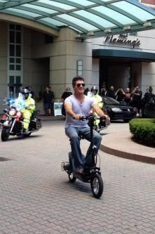 "Police were ALL OVER Simon Cowell this morning in Rhode Island -- providing a escort just for the ""X Factor"" judge on his way to auditions . while he rode on a dinky little scooter. Boat Wraps, Love Simon, Britain Got Talent, Simon Cowell, Talent Show, Rhode Island, Hot Wheels, Celebrity News, Kim Kardashian"