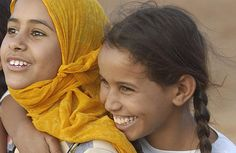 photo by United Nations Photo on Flickr. It's good to see smiles even in a refugee camp - children from Western Sahara in Dakhla Refugee Camp, Algeria.