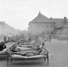 """After their liberation by the British army on 15 April 1945 the survivors of the concentration camp of Bergen-Belsen were brought to the nearby former Wehrmacht barracks where they received medical care. The deported from all over Europe to Germany concentration camp prisoners and forced laborers received by the Allies the legal status of """"displaced persons"""" (DPs). They thus had a right to special care.27. April 1945. Foto Sgt. Oakes. Imperial War Museum, London, Photograph Archive, BU 4844"""