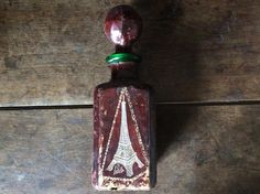 Vintage French Paris Eiffel Tower leather wrapped glass decanter circa 1970's Purchase in store here http://www.europeanvintageemporium.com/product/vintage-french-paris-eiffel-tower-leather-wrapped-glass-decanter-circa-1970s/