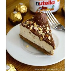 No-Bake Ferrero Rocher Cheesecake is the most popular recipe on my blog for a reason!  Buttery biscuit base, vanilla cheesecake speckled with chopped Ferrero Rocher and a layer of Nutella. This is one decadent dessert!  Recipe link in bio!