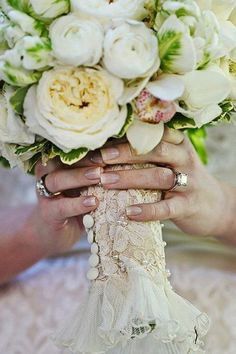 Sweet Wedding Bouquet Details: Did your mother preserve her wedding dress? If so, and you don't plan on wearing it, use a piece of fabric to wrap around your bridal bouquet. This is one of the wedding details you can use to honor your parents!