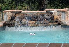 Superior pools www.superiorpoolsswfl.net  Spa with rock spillway
