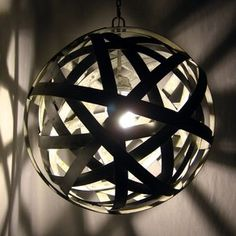 Orbits, urban chandelier, recycled wine barrel metal hoops, galvanized steel bands, ceiling light fixture custom made by Stil Novo Design