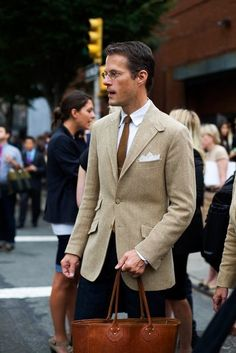 Tan sport coat, white shirt, brown tie, navy trousers