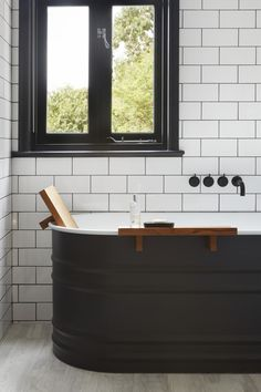 Monochrome bathroom with dark grey feature bath with match Vola sanitary ware Architects London, Residential Architect, Getting Out, Powder Room, Bad, Monochrome, Bath Photography, New Homes, Contemporary