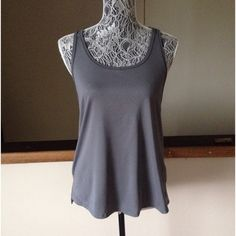 Under Armour Running Tank Sz M Like new UA tank in charcoal gray.  Generous cut looks cute over a coordinating sports bra!   Worn once.  Hand washed cold. Under Armour Tops Tank Tops