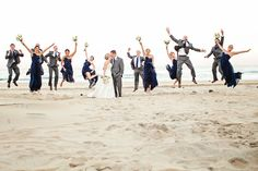 Fun wedding party pic in the sand.
