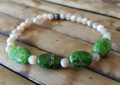 Limited Edition Nola bracelet benefiting the Rhino Rescue Center. Mother of Pearl and green jasper.