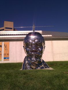 """""""Miss Mao Trying to Poise Herself at the Top of Lenin's Head,"""" stainless steel sculpture by The Gao Brothers, Kemper Museum, Kansas City, MO"""