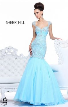 Get your mermaid on in this fabulously stylish dress, Sherri Hill 21036 ! This gorgeous mermaid dress will rock your figure right. Perfect for Prom, New Years Eve, or a black tie cocktail party, this look will ensure you stay in the spotlight. A soft sweetheart neckline hugs the body and provides lots of support with its triangle straps. The mid back is modest and lets the dress speak for itself! A stunning look, dont pass on Sherri Hill 21036.