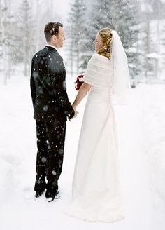 Winter wedding wedding outdoors winter couple snow bride groom