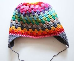 This rainbow beanie is like a color therapy! Seriously! All those colors combined in a beautiful pattern that looks so great and it's wearable! This Rainbow Beanie by Revlie Schuit can be done in two different versions: with or without earflaps so it's basically perfect for at least three seasons. Crocheted with the lovely granny-square stitch …