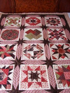 A Lovely warm sampler ...quilted by Charisma