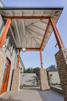 Breath taking double story entrance with exposed trusses & custom timber posts