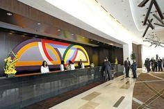 "Frank Stella's 32-foot-long ""Damascus Gate Variation I,"" installed behind the reception desk at Vdara."