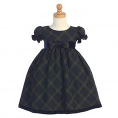 A beautiful Christmas dress for your little girl by Lito.  This classic green plaid dress features short sleeves and black velvet trim at th...