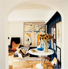 There's something about this space that I love.  The lived in,  artistic and natural feel.  The colors are so exciting add well.