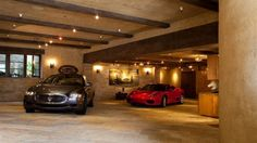 Masculine finished garage with exposed wood beams and tiled floors. I like it but I need more lights. Underground Garage, Underground Homes, Home Design, Design Garage, Garage Pictures, Finished Garage, Landscape Arquitecture, Ultimate Garage, Garage Lighting