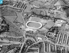 The greyhound and speedway of Wimbledon Sports Stadium, Wimbledon, 1928 is the centre stadium. Above to the left is Wimbledon FC, an Isthmian League team at the time.