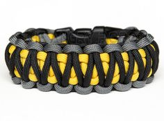 Paracord Bracelet King Cobra - Grey Black with Yellow Core by theangryrobot on Etsy https://www.etsy.com/listing/117637503/paracord-bracelet-king-cobra-grey-black