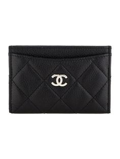 Black leather Chanel Caviar card holder with quilted stitching throughout, silver-tone CC at front and four slit pockets. Serial number reads 1106217.