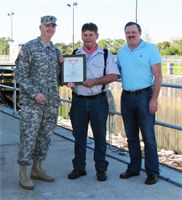 Lt. Col. Thomas Greco presented St. Lucie Lock Leader Michael L. Carter (center) with the Steel de Fleury Medal Dec. 19 at the St. Lucie Lock in Stuart, Fla. Also present was South Florida Operations Office Chief, Steve Dunham (right).  http://www.saj.usace.army.mil/Media/NewsStories/tabid/6070/Article/7894/corps-lock-leader-receives-steel-de-fleury-medal.aspx#