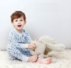 Fall-Winter 2016: Petidoux's silky, breathable pajamas come in soft shades and mid-tones on white grounds, so colors pop as on the boy's penquin print. www.petidoux.com
