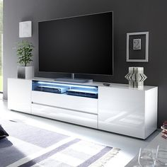 203 cm wide - Genie Wide LCD TV Stand In White High Gloss With 2 Doors And 2 Drawers also one Black Glass Fronts Lid and LED Lighting look beautiful in any modern decor Finish: White High Gloss And Glass Feature...