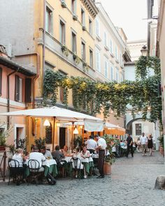 One of the best ways to experience Rome is to sit at a table outside, along a cobblestoned street, eat pasta and drink it all down with a glass (or two) of
