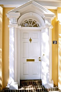 love the doorway and against the yellow really stands out