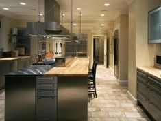 """Serious Culinary    Some high-end, industrial kitchens feel like the back of a restaurant. The kitchen should certainly feel efficient and top of the line but with the comfort of a warm and inviting home. To create that """"home-sweet-home"""" feeling, designer"""