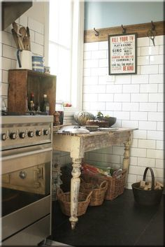 loving the rustic wood trim with the crisp white tile & blue walls.