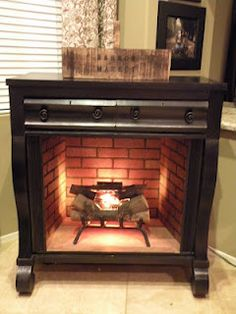 Old Dresser Turned Fireplace Mantel.   Not crazy about this one, but it's an intriguing concept.
