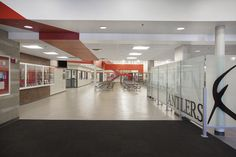 Elkhorn High School in Elkhorn, Ne. Front entrance with feature wall leading into the cafeteria. http://www.kurtjohnsonphotography.com/