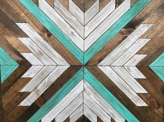 DESCRIPTION This gorgeous rustic geometric style wood pattern wall art is an eye catcher. It is made with pine stained different colors to give it a rustic reclaimed wood look with a hint of white and turquoise distressed in there. The colors are quite exquisite together. No two