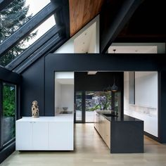 Minimalist graphic renovation opens to an outdoor deck.