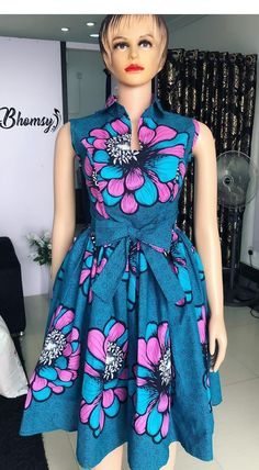 Call, SMS or WhatsApp 2348144088142 if you want this style, needs a skilled tailor to hire or you want to expand more on your fashion business. Short African Dresses, Latest African Fashion Dresses, African Print Dresses, African Print Fashion, Africa Fashion, African Print Dress Designs, Ankara Designs, Ankara Styles, Wrap Dress Floral