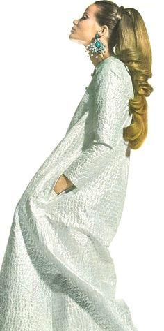 Veruschka is wearing a long silvery djellaba dress, 1966