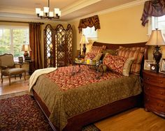 Master bedroom - red, tans, browns, antique furniture, large windows, wood floors