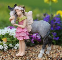 Enhance your fairy village with this whimsical Fairy. Miniatures are small items that pose potential choking hazards to small children. They are not toys. Any accessories pictured are not included and
