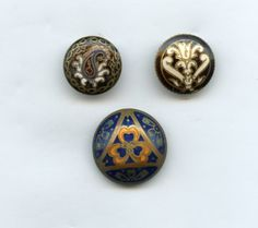 SOLD: 3 antique enamel buttons one has a paisley pattern