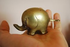 Antique SOLID BRASS ELEPHANT. $33.00, via Etsy.